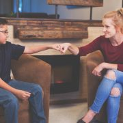 Foster Care Woman and Boy Child Talking inside a retro home