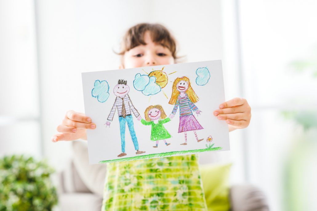 Family foster care child shows viewer a drawing of her foster family.