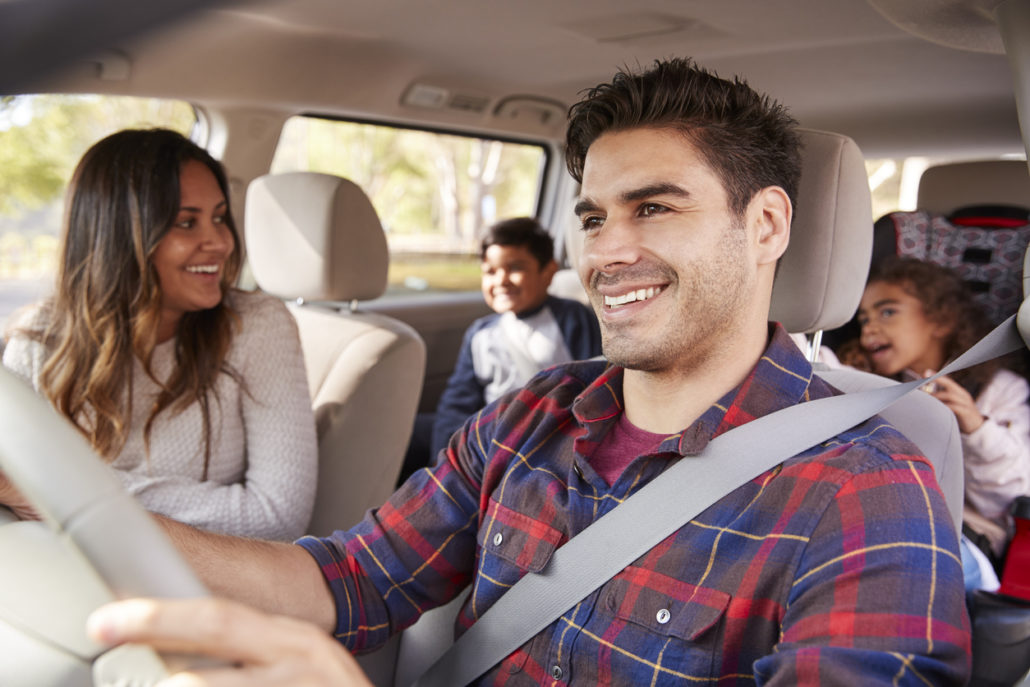 foster parent driving kids in car