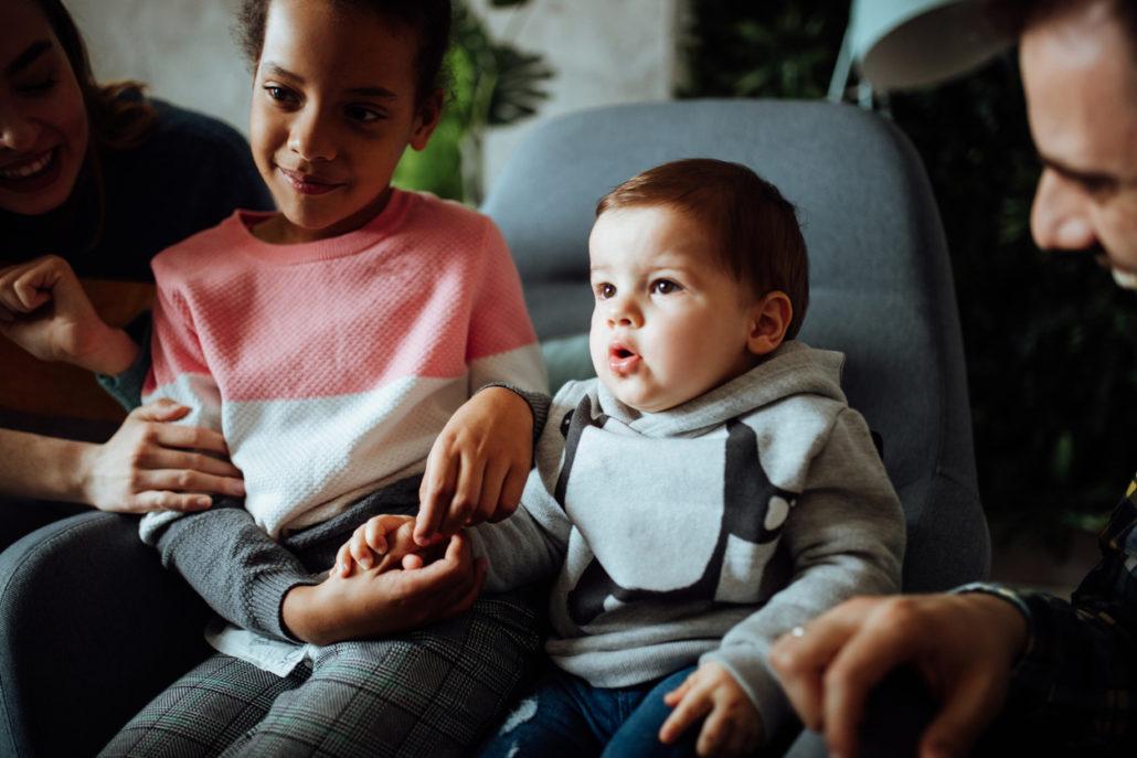 foster parent watching TV with foster children