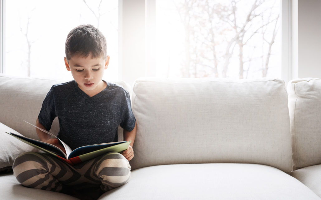 foster kids read at home on the couch