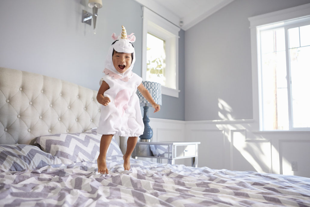 Angie's story ends well while she ju,ps on bed with unicorn costume