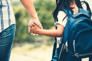 foster mother walking her foster daughter to school to make a difference