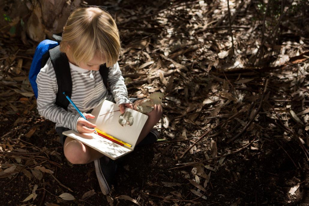 writing in her gratitude journal